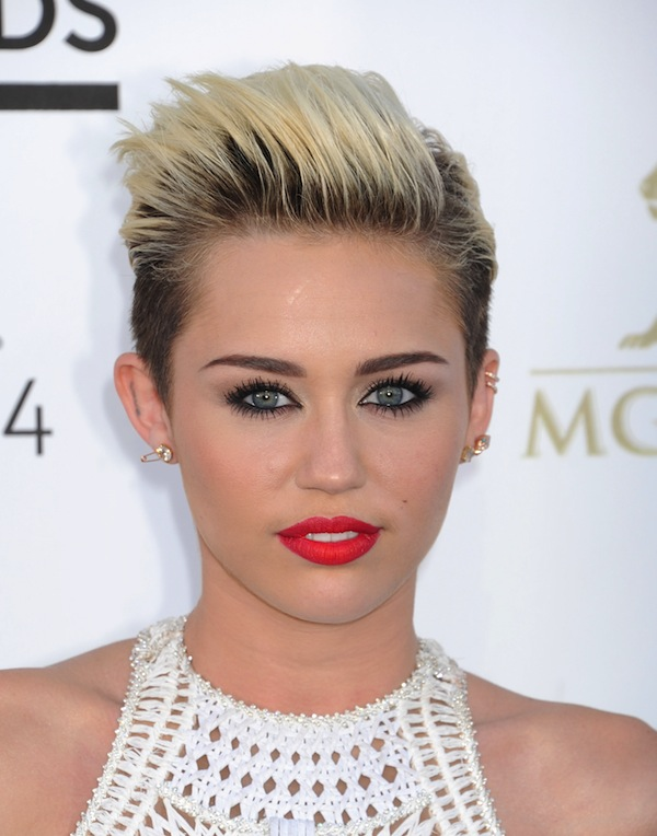Photos: Miley Cyrus goes topless again at the beach ...