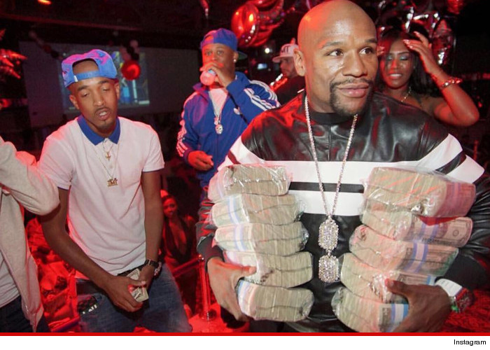 Floyd Mayweather leaves a sub for Conor McGregor while flaunting dollar bills