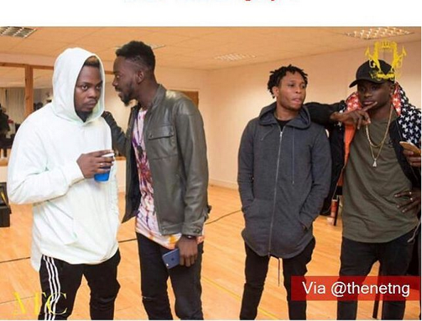 Do you know what's distracting Olamide and Viktoh in this photo or are you among the 4 percent?