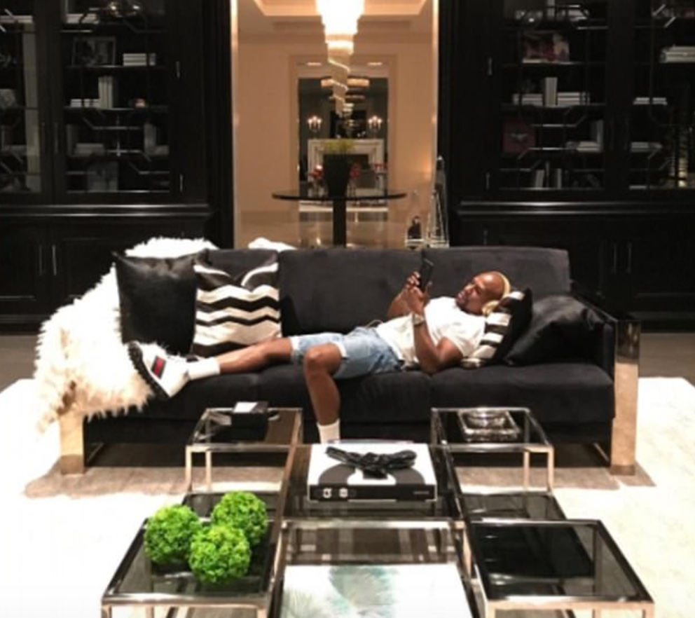 Floyd Mayweather moves into his new $26million mansion, poses in his massive wine cellar