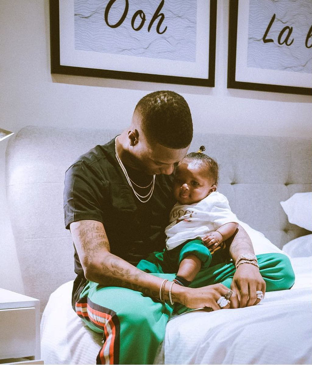 Wizkid Buys A Customized Iced-Out Gold Chain For His Third Son, Zion